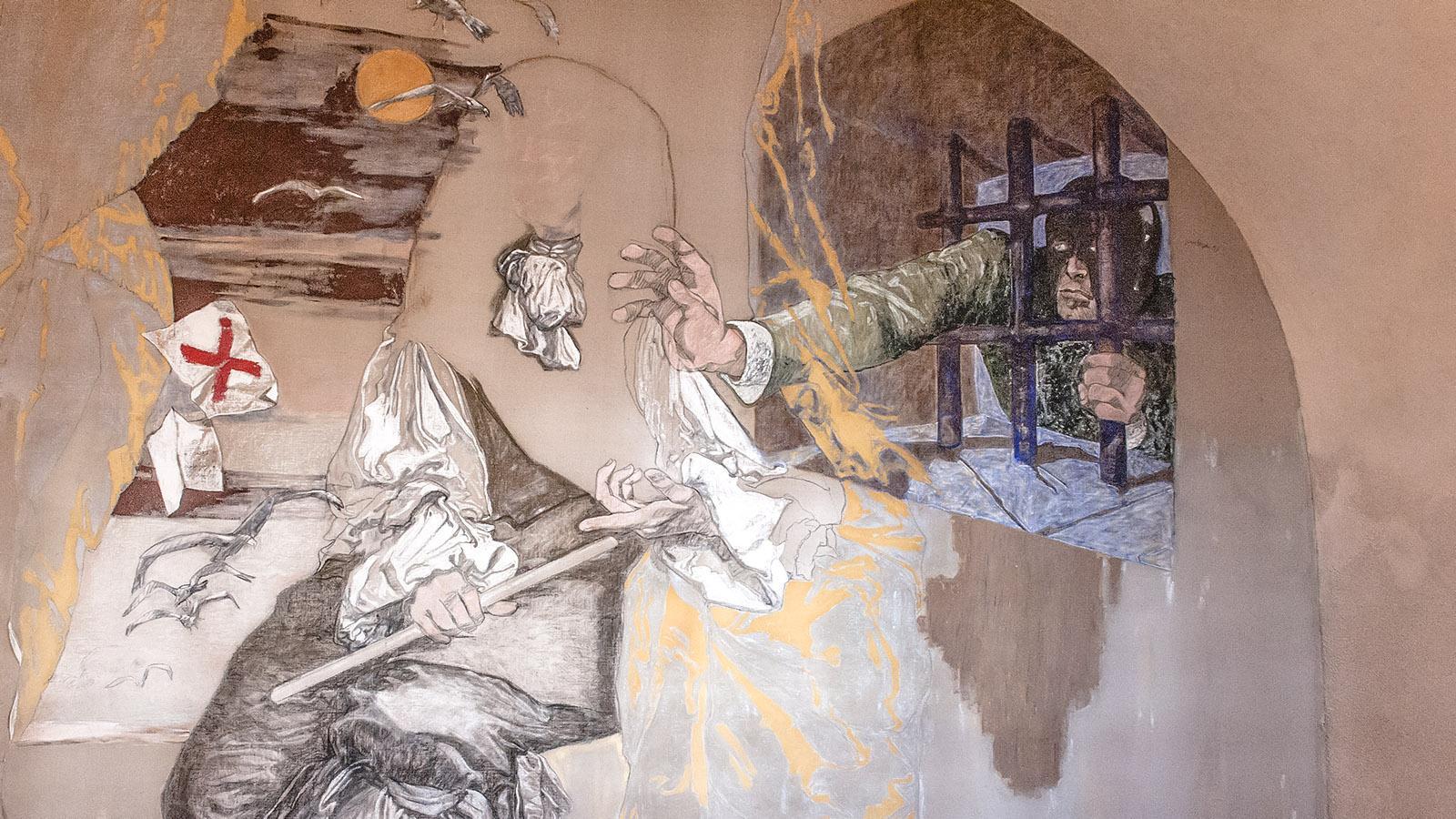 Sainte-Marguerite: der Mann mit der schwarzen Maske als Wandbild - zu sehen im Zellentrakt der Festung. Foto: Hilke Maunder