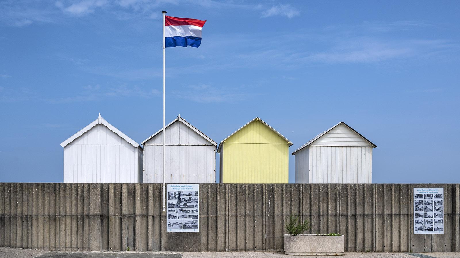 Die Strandhütten von Saint-Aubin erzählen mit historischen Aufnahmen von den ersten Jahren des Badelebens. Foto: Hilke Maunder