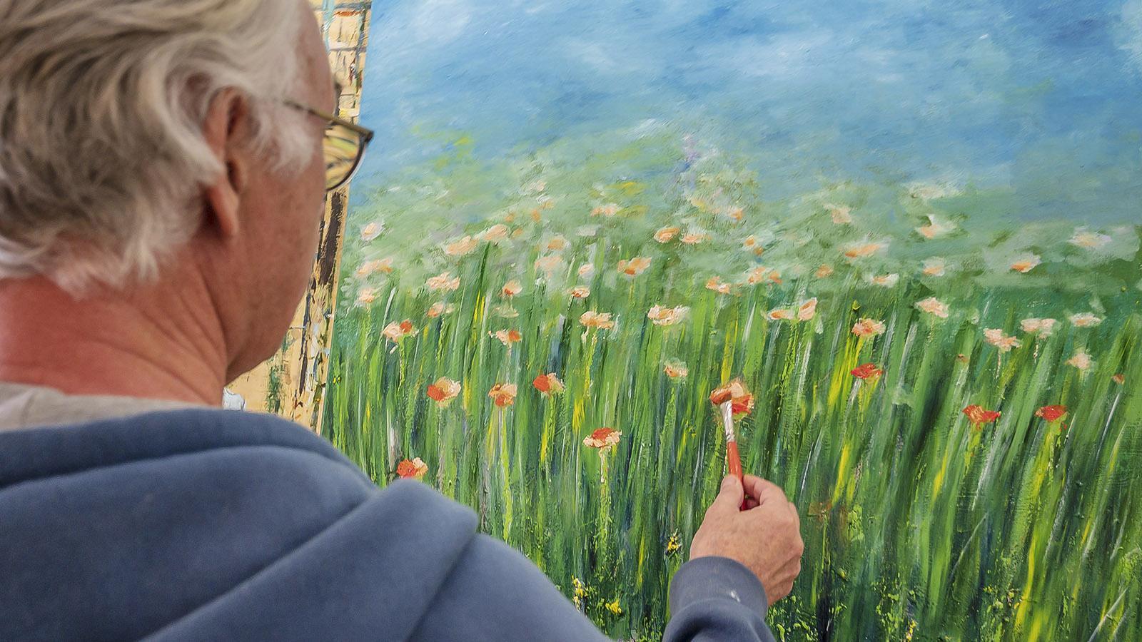 Phlippe Roitg beim Malen. Foto: Hilke Maunder